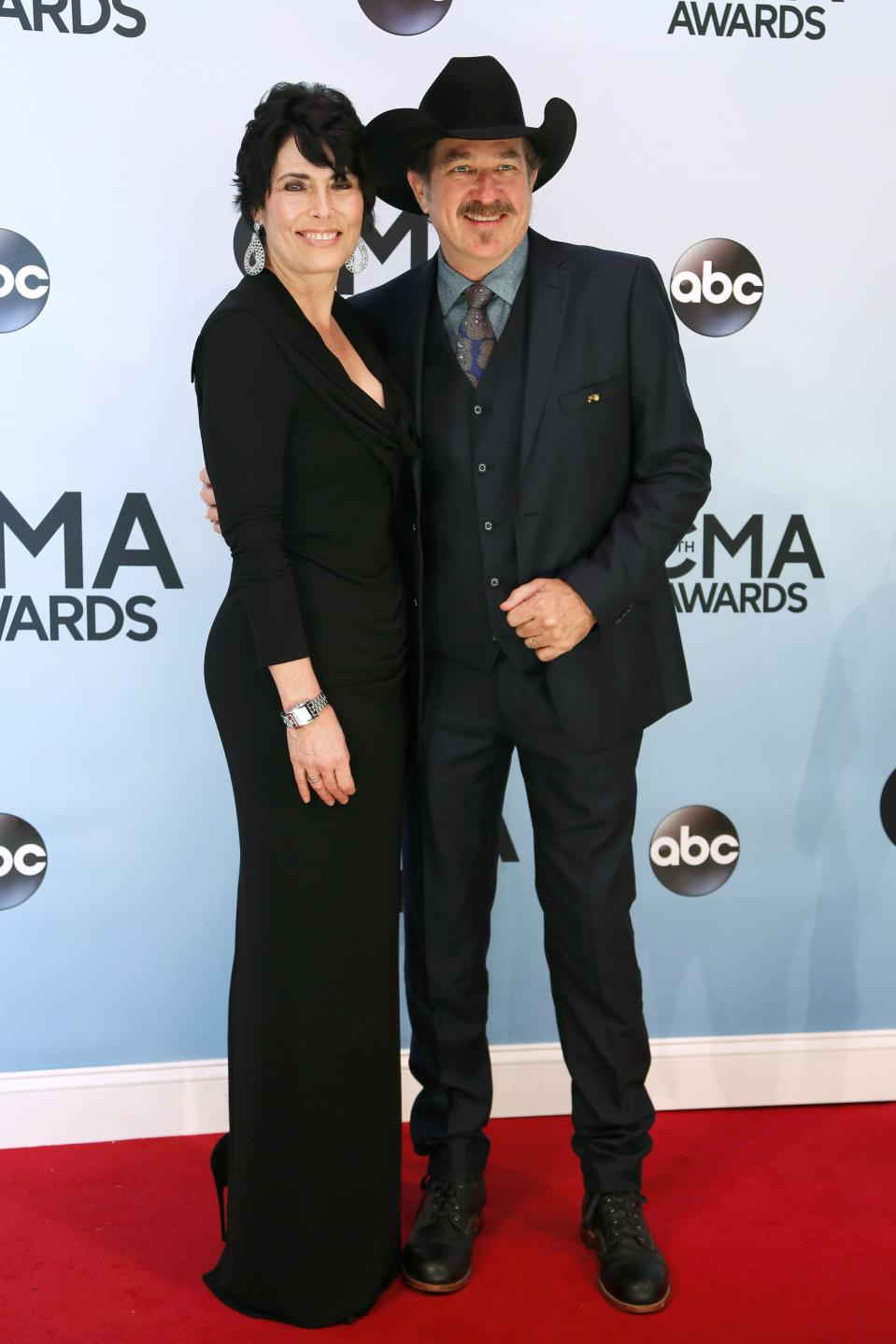 Kix Brooks and his wife Barbara pose on arrival at the 47th Country Music Association Awards in Nashville, Tennessee November 6, 2013. REUTERS/Eric Henderson (UNITED STATES - Tags: ENTERTAINMENT)