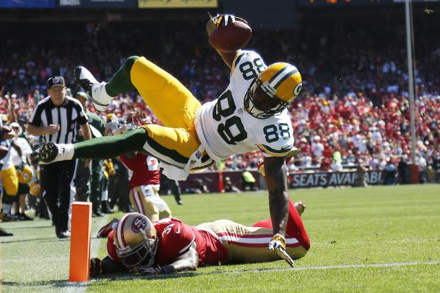 Green Bay Packers Jermichael Finley leaps for a touchdown during his NFL season home opener football game against the San Francisco 49ers in San Francisco