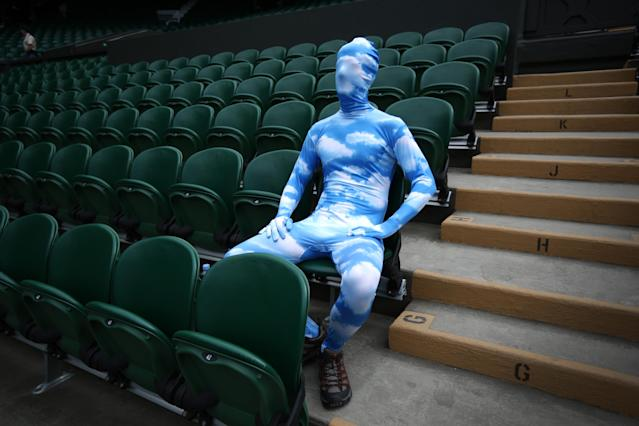 LONDON, ENGLAND - JULY 01: Tennis fan Chris Fava wears a blue sky body suit as he waits for the start of play on Centre Court on day seven of the Wimbledon Lawn Tennis Championships at the All England Lawn Tennis and Croquet Club on July 1, 2013 in London, England. (Photo by Peter Macdiarmid/Getty Images)