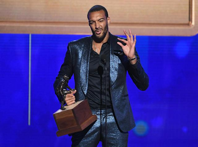 SANTA MONICA, CALIFORNIA - JUNE 24: Rudy Gobert accepts the Kia NBA Defensive Player of the Year award onstage during the 2019 NBA Awards presented by Kia at Barker Hangar on June 24, 2019 in Santa Monica, California. (Photo by Kevin Winter/Getty Images for Turner Sports)
