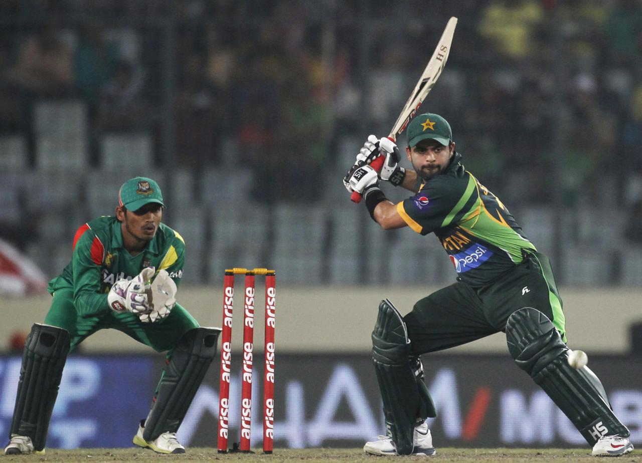 Pakistan's Ahmed Shehzad plays a ball as Bangladesh's wicketkeeper Anamul Haque (L) watches during their one-day international (ODI) cricket match in Asia Cup 2014 in Dhaka March 4, 2014. REUTERS/Andrew Biraj (BANGLADESH - Tags: SPORT CRICKET)