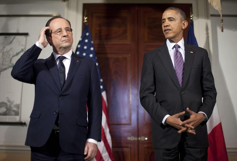 President Barack Obama, right, and French President Francois Hollande, left, pause as they talk to members of the media following their tour of Monticello, President Thomas Jefferson's estate, Monday, Feb. 10, 2014, in Charlottesville, Va. (AP Photo/Pablo Martinez Monsivais)