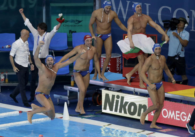 Italian players celebrate after defeating Spain in their men's water polo gold medal match at the World Swimming Championships in Gwangju, South Korea, Saturday, July 27, 2019. (AP Photo/Mark Schiefelbein)