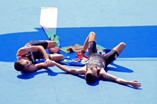 Great Britain's Alistair Brownlee, left, and brother Jonny embrace after winning gold and silver respectively in the men's triathlon at the Rio de Janeiro Olympics in 2016. In sweltering conditions at Fort Copacabana, Alistair pulled away from his younger sibling about halfway through the 10k run to retain his Olympic title by six seconds (Mike Egerton/PA)