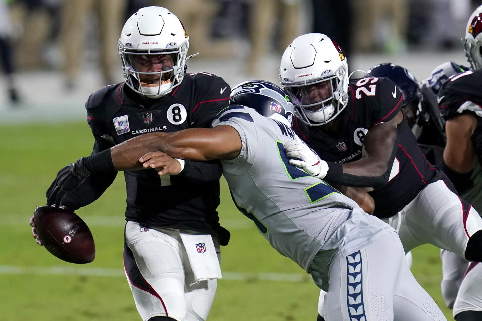 Arizona Cardinals quarterback Kyler Murray avoids the sack as Seattle Seahawks middle linebacker Bobby Wagner, right, makes the hit during the first half of an NFL football game, Sunday, Oct. 25, 2020, in Glendale, Ariz. (AP Photo/Ross D. Franklin)