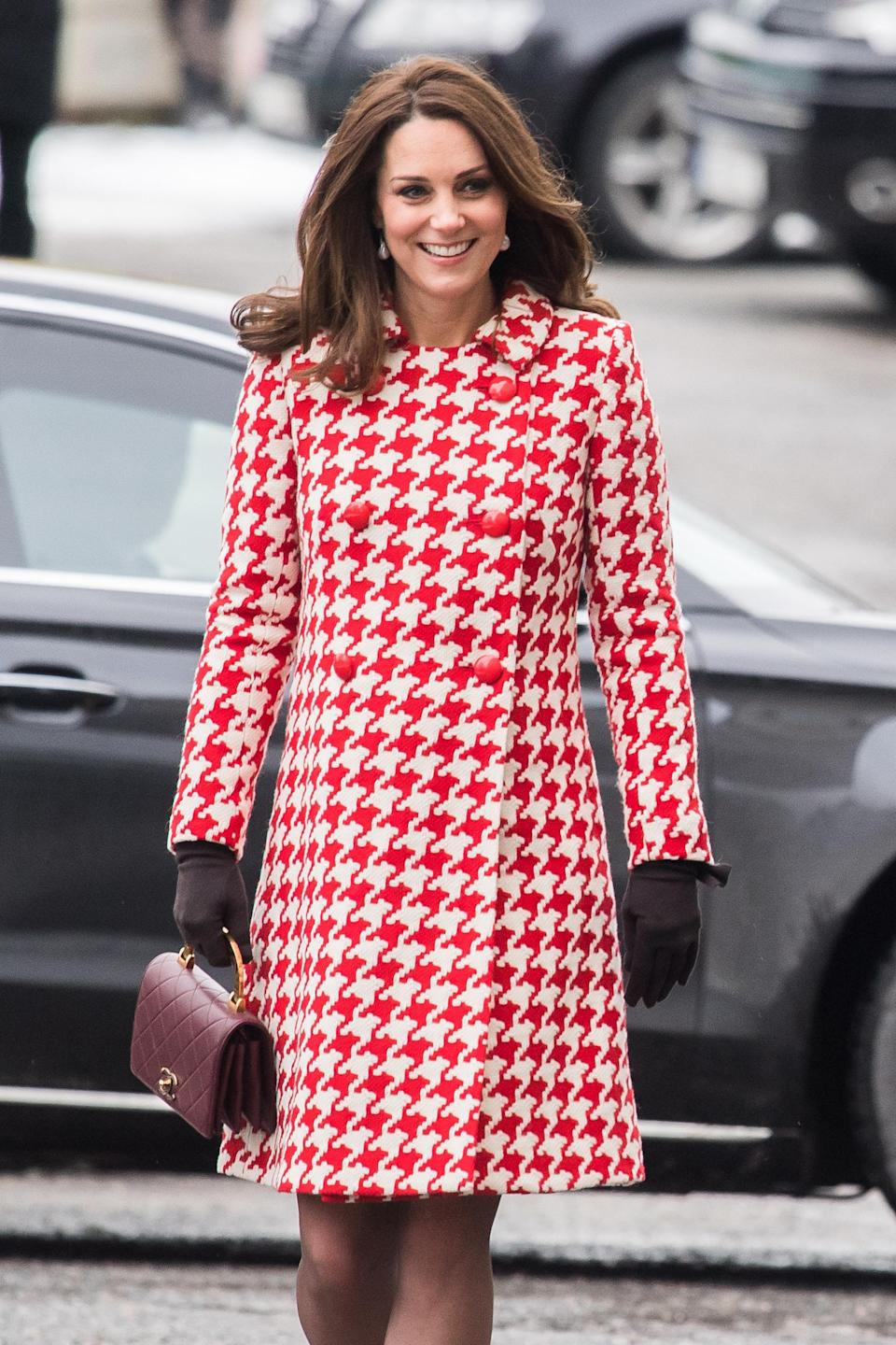 <p><strong>The occassion:</strong> A visit to Matteusskolan School on day two of the Duke and Duchess's royal visit to Sweden and Norway.<br><strong>The look:</strong> A '60s-style red-and-white houndstooth coat by Catherine Walker, semi-opaque tights, burgundy block heels by Tod's and a matching burgundy Chanel Nouvelle Flap Bag from the brand's autumn/winter 15 collection.<br>[Photo: Getty] </p>