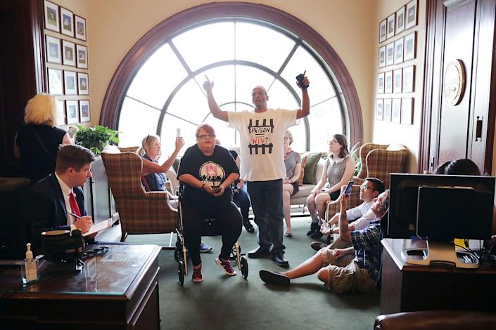 <p>Demonstrators from Ohio occupy the offices of Sen. Rob Portman during a protest against health care reform legislation in the Russell Senate Office Building on Capitol Hill July 10, 2017 in Washington, D.C. (Photo: Chip Somodevilla/Getty Images) </p>