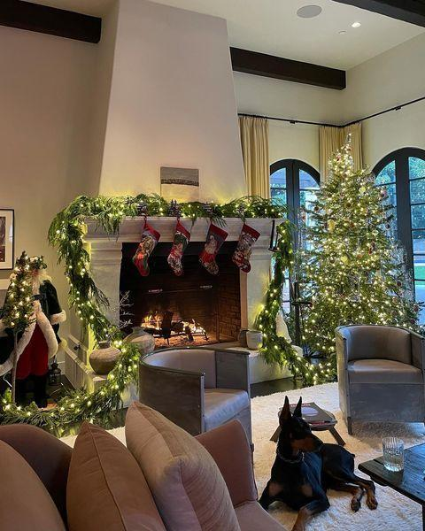 "<p>The model showed off her festive decor on Instagram, opting for green and soft yellow lighting, a decoration-free Christmas tree and four red stockings lined on her fireplace. 'Tequila and pup,' she captioned the Christmas-inspired photos. </p><p><a href=""https://www.instagram.com/p/CIrXdVXjmKu/?utm_source=ig_web_copy_link"" rel=""nofollow noopener"" target=""_blank"" data-ylk=""slk:See the original post on Instagram"" class=""link rapid-noclick-resp"">See the original post on Instagram</a></p>"