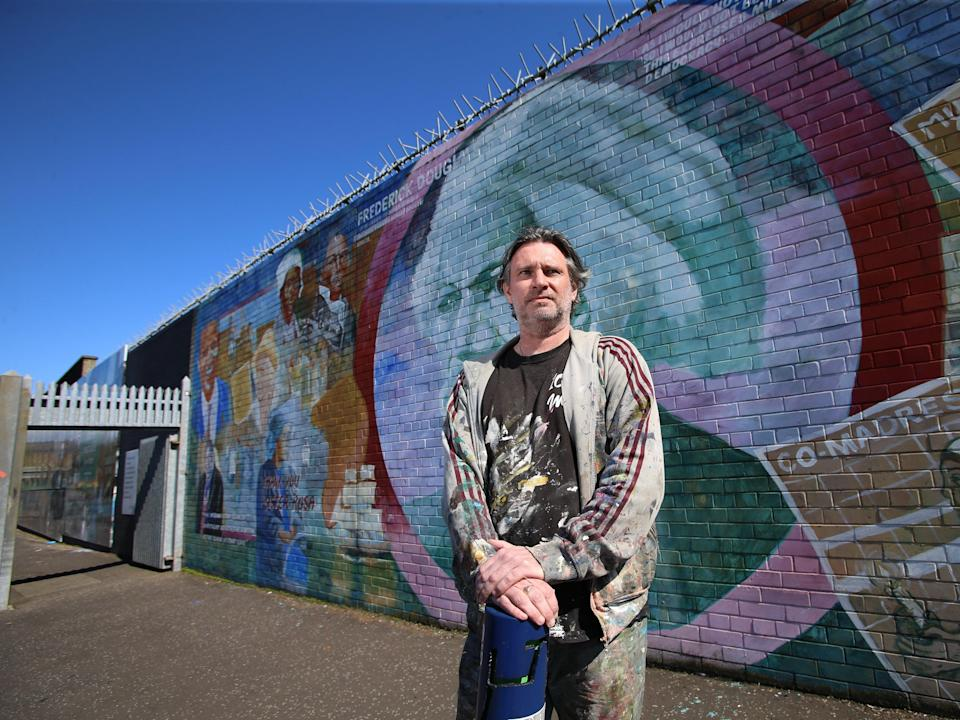 Mark Ervine, street artist and son of the late Progressive Unionist Party (PUP) leader David Ervine, stands near a mural he worked on on the peace line in West BelfastPaul McErlane