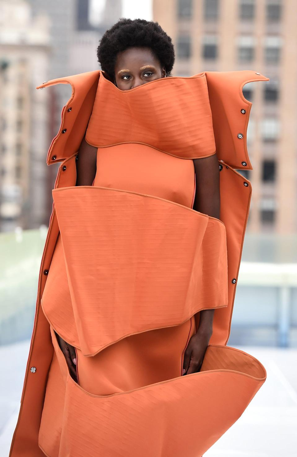 <p>This Flying Solo runway model made a statement with gold eyebrows that complemented her bright outfit.</p>