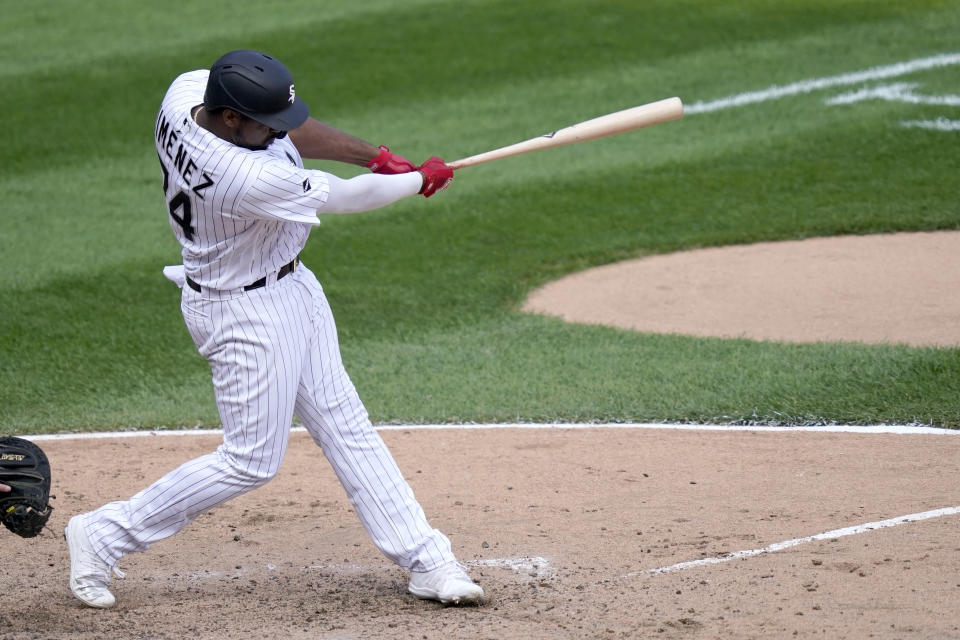 Chicago White Sox's Eloy Jimenez hits an RBI double off Minnesota Twins relief pitcher Sergio Romo during the seventh inning of a baseball gamem Thursday, Sept. 17, 2020, in Chicago. Yolmer Sanchez scored on the play. (AP Photo/Charles Rex Arbogast)