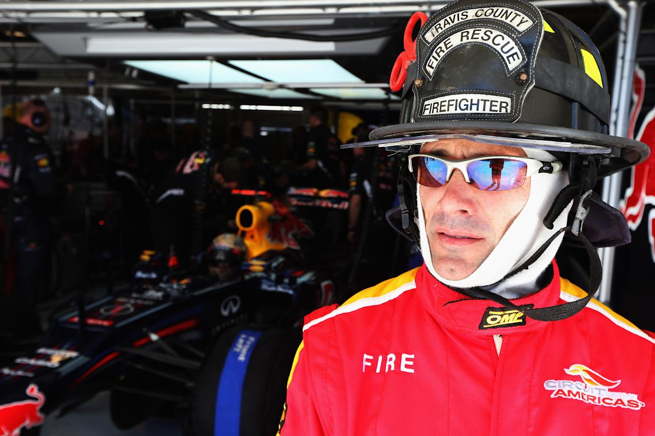 AUSTIN, TX - NOVEMBER 17:  Fire marshall is seen outside the garage of Sebastian Vettel of Germany and Red Bull Racing during qualifying for the United States Formula One Grand Prix at the Circuit of the Americas on November 17, 2012 in Austin, Texas.  (Photo by Mark Thompson/Getty Images)