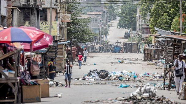 PHOTO: Garbage litters a street in the Bel-Air neighborhood of Port-au-Prince, July 13, 2021, in the wake of Haitian President Jovenel Moise's assassination on July 7. (Valerie Baeriswyl/AFP via Getty Images)