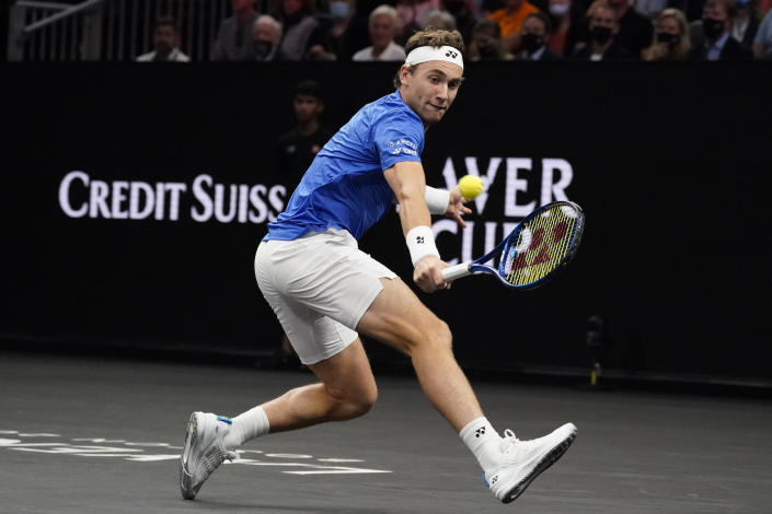 Europe's Casper Ruud, of Norway, returns the ball to World's Reilly Opelka, of the USA, at Laver Cup tennis, Friday, Sept. 24, 2021, in Boston. (AP Photo/Elise Amendola)