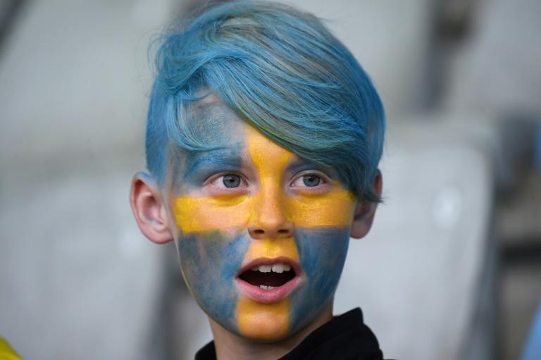 A younh Sweden supporter cheers ahead of the UEFA Women's Euro 2017 football match between Sweden and Italy at the Stadion De Vijverberg in Doetinchem (AFP Photo/DANIEL MIHAILESCU)