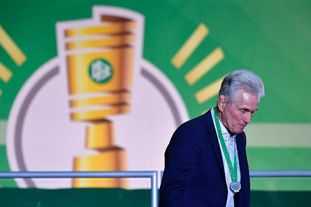 Bayern Munich's German head coach Jupp Heynckes walks with his medal past a logo of the German Cup DFB Pokal after the German Cup DFB Pokal final football match FC Bayern Munich vs Eintracht Frankfurt at the Olympic Stadium in Berlin on May 19, 2018. (AFP Photo/Tobias SCHWARZ)