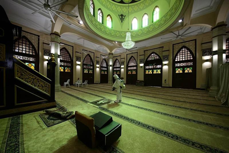 Cleaning operations taking place at the Hajjah Fatimah Mosque on Beach Road. (PHOTO: Muis)