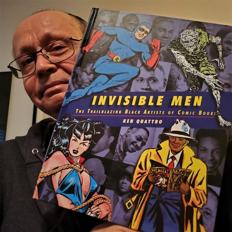 """Ken Quattro of southeast Michigan holds a copy of his new book, """"Invisible Men: The Trailblazing Black Artists of Comic Books."""""""