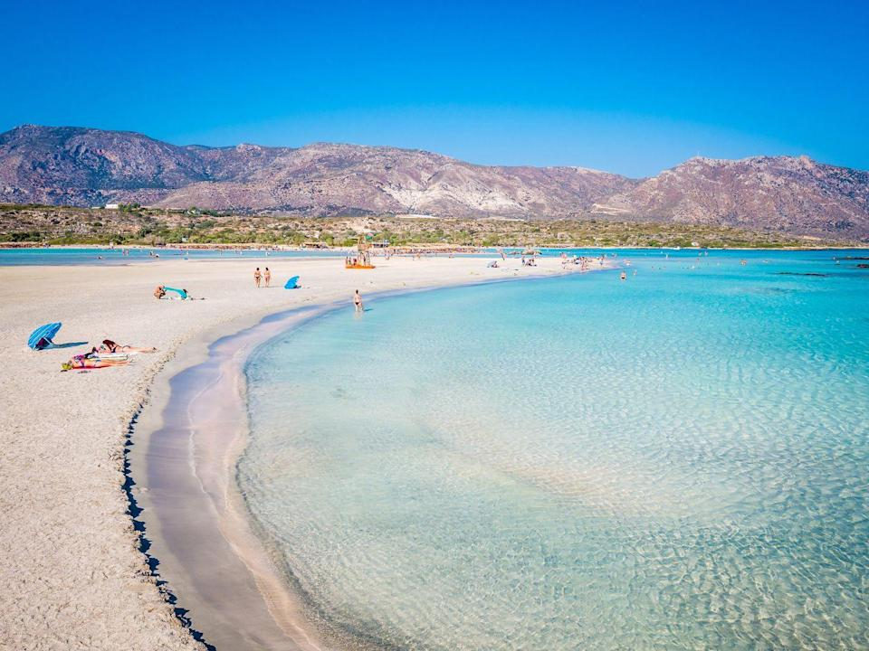<p>No, you're not looking at a Windows Screensaver. The scenic lagoon in Crete offers shallow, turquoise waters, white & pink sand, chair rentals & water sports, making it perfect for a day lounging in the sun. </p>