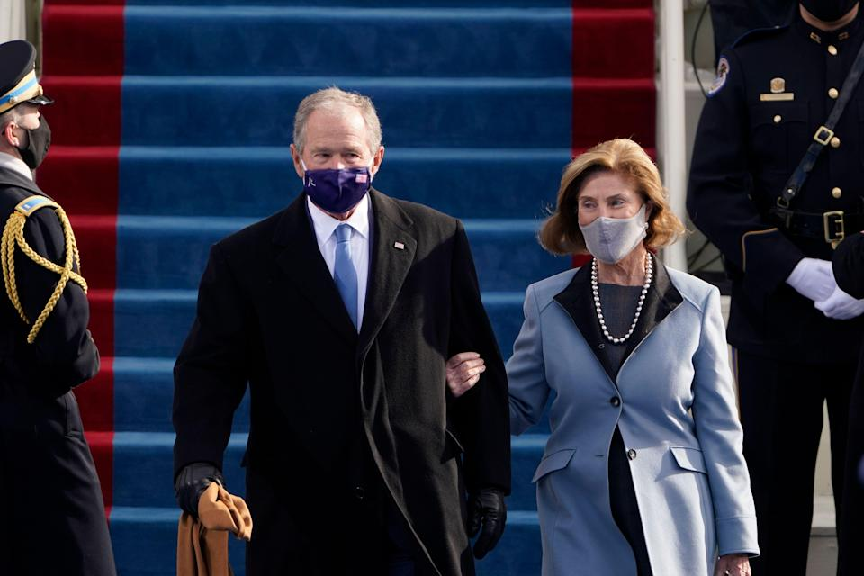 Former President George W Bush and his wife Laura arrive for the 59th Presidential Inauguration at the US Capitol for President-elect Joe Biden in Washington.