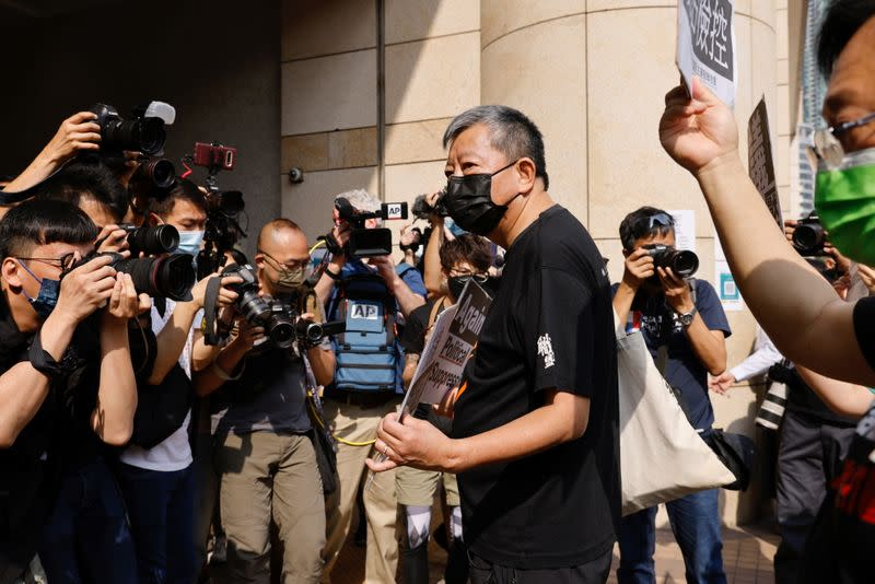 Pro-democracy activist Lee Cheuk-yan arrives at the West Kowloon Courts for verdicts in landmark unlawful assembly case, in Hong Kong