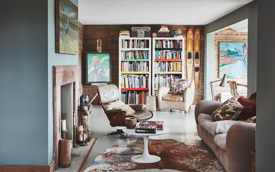 Wood cladding gives the interior of the house a warm, rustic feel, which the couple have enhanced with vintage furniture and collectibles - Malcolm Menzies/Living Inside
