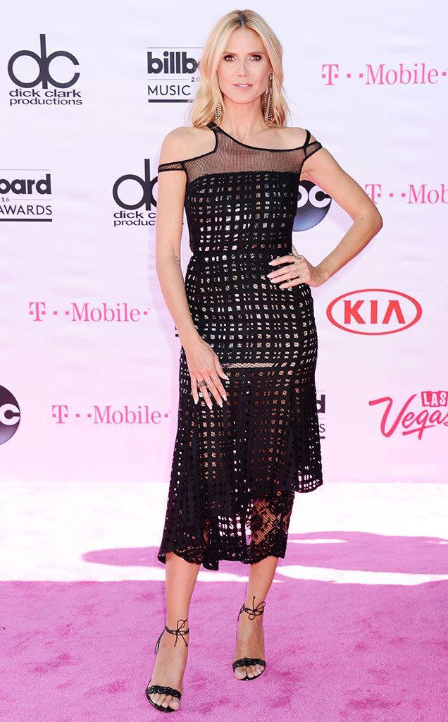 <p>Presenter Klum kept her look low-key and gorgeous with a simple black dress and easy breezy hair and makeup. <i>(Photo: Broadimage/REX/Shutterstock)</i></p>
