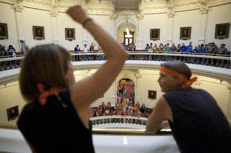 Hallie Boas and Lisa Fithian lead abortion rights chants from the third floor of the Texas Capitol Rotunda in Austin, Texas on Friday, July 12, 2013. The Texas Senate's leader, Lt. Gov. David Dewhurst, has scheduled a vote for Friday on the same restrictions on when, where and how women may obtain abortions in Texas that failed to become law after a Democratic filibuster and raucous protesters were able to run out the clock on an earlier special session. (AP Photo/Tamir Kalifa)