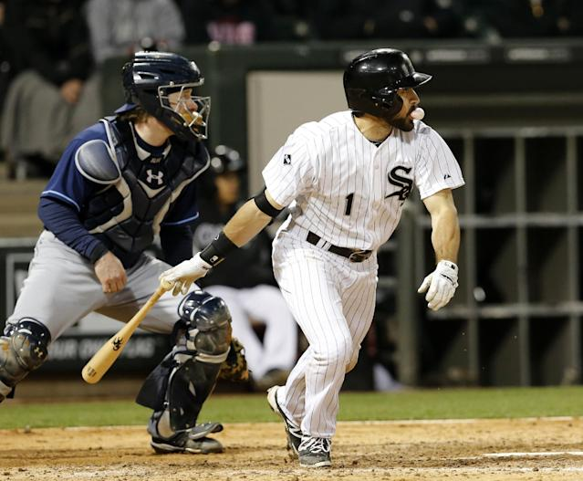 Chicago White Sox's Adam Eaton (1) hits a two-run double off Tampa Bay Rays relief pitcher Jake McGee, scoring Tyler Flowers and Marcus Semien, during the sixth inning of a baseball game Monday, April 28, 2014, in Chicago. Watching on the play is Rays Ryan Hanigan. (AP Photo/Charles Rex Arbogast)