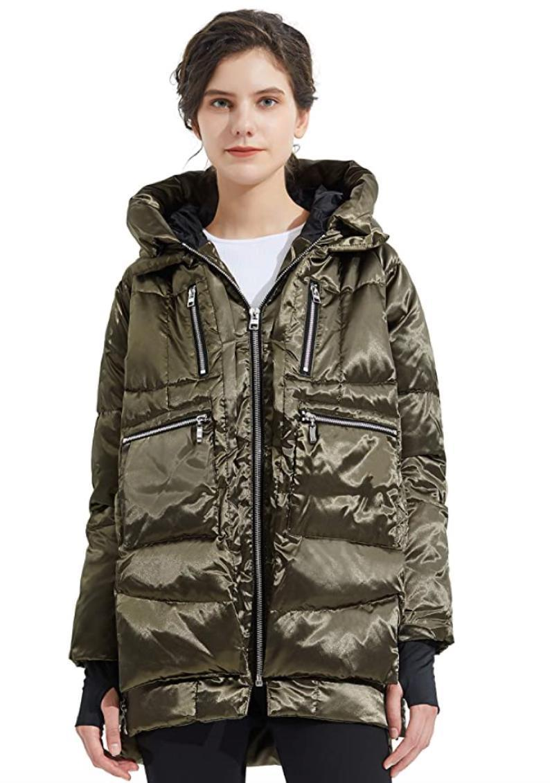 """It's not a regular puffer, it's a <em>cool</em> puffer—thanks to this slight shimmer effect that will catch light amazingly. $140, Amazon. <a href=""""https://www.amazon.com/Orolay-Womens-Thickened-Jacket-Hooded/dp/B07ZYFZRV1"""" rel=""""nofollow noopener"""" target=""""_blank"""" data-ylk=""""slk:Get it now!"""" class=""""link rapid-noclick-resp"""">Get it now!</a>"""