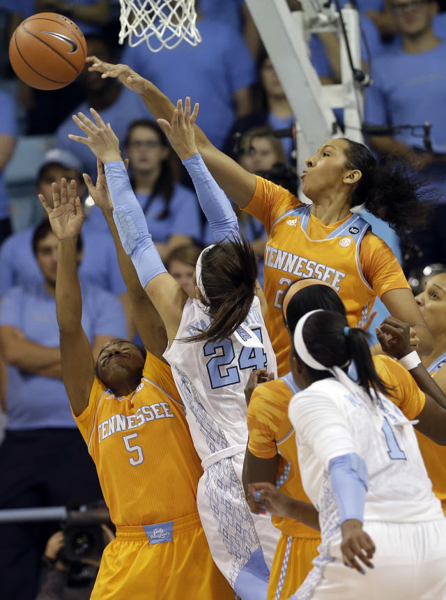 North Carolina's Jessica Washington (24) is blocked by Tennessee's Mercedes Russell, right, and Ariel Massengale (5) during the first half of an NCAA college basketball game in Chapel Hill, N.C., Monday, Nov. 11, 2013. (AP Photo/Gerry Broome)