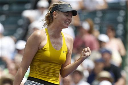 Mar 24, 2014; Miami, FL, USA; Maria Sharapova reacts against Kirsten Flipkens (not pictured) on day eight of the Sony Open at Crandon Tennis Center. Geoff Burke-USA TODAY Sports