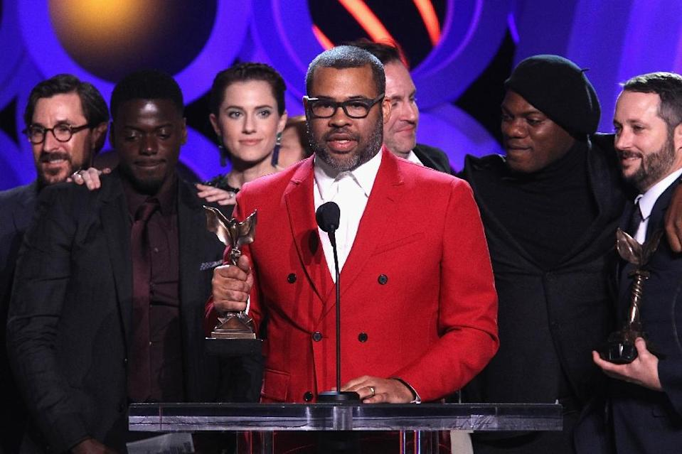 """Actor/writer/director Jordan Peele, center, accepts the award for best feature for """"Get Out"""" at the 2018 Film Independent Spirit Awards in Santa Monica, Calif., on the eve of the Oscars. (AFP Photo/Tommaso Boddi)"""