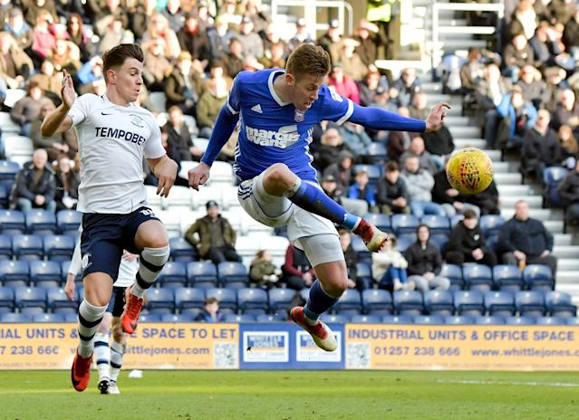 """Soccer Football - Championship - Preston North End vs Ipswich Town - Deepdale, Preston, Britain - February 24, 2018 Preston's Joshua Harrop in action with Ipswich Town's Adam Webster Action Images/Paul Burrows EDITORIAL USE ONLY. No use with unauthorized audio, video, data, fixture lists, club/league logos or """"live"""" services. Online in-match use limited to 75 images, no video emulation. No use in betting, games or single club/league/player publications. Please contact your account representative for further details."""
