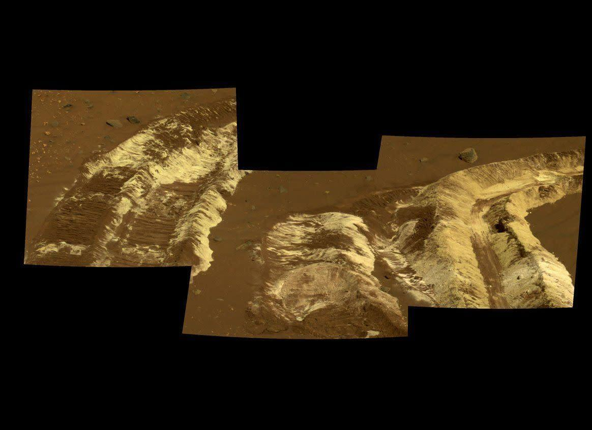 """This Spirit Pancam sol 788 (April 12, 2006) mosaic shows a dramatic example of whiteish and yellowish salty soils dug up by the rover's wheels in what may once have been a hydrothermal vent near the ancient volcanic feature called Home Plate. <em>From """"Postcards from Mars"""" by Jim Bell; Photo credit: NASA/JPL/Cornell University</em>"""