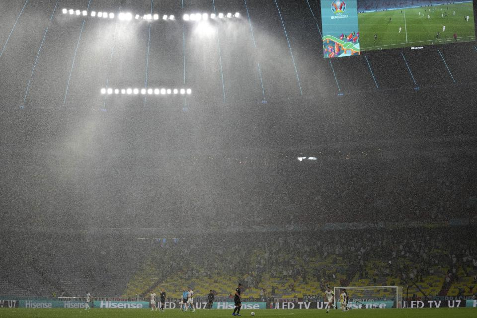 Heavy rain falls during the Euro 2020 soccer championship group F match between Germany and Hungary at the Allianz Arena in Munich, Germany, Wednesday, June 23, 2021. (AP Photo/Matthias Schrader, Pool)