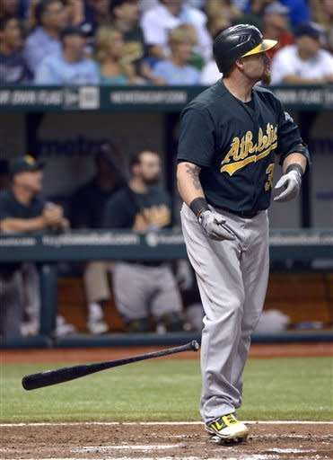 Oakland Athletics' Jonny Gomes watches his two-run home run during the eighth inning of a baseball game against the Tampa Bay Rays in St. Petersburg, Fla., Friday, Aug. 24, 2012. (AP Photo/Phelan M. Ebenhack)