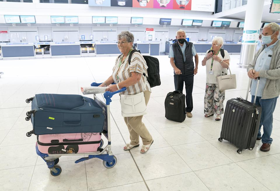 (left to right) Maggie Smith, Bernard Smith, Rosemary Gallacher and Ralph Smith head to the Jet2 check-in desk at Glasgow Airport (Jane Barlow/PA) (PA Wire)