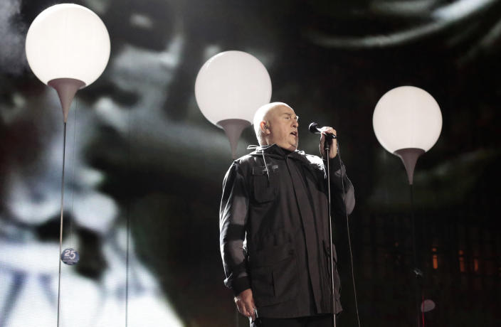 "FILE - British singer Peter Gabriel performs the song ""heroes"" during the central event to commemorate the Fall of the Wall at the Brandenburg Gate in Berlin, Germany on Nov. 9, 2014. Gabriel turns 71 on Feb. 13. (AP Photo/Markus Schreiber, File)"