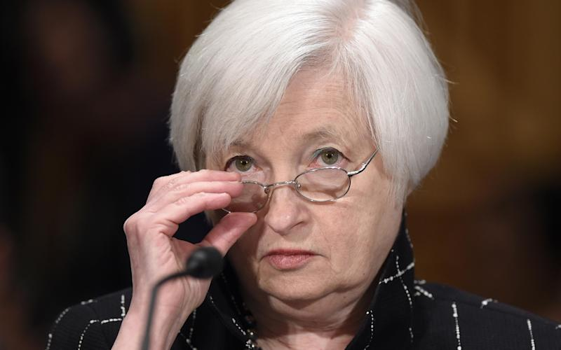 The Fed, headed by Janet Yellen, is going to run down its stock of bonds very gradually - Susan Walsh/AP