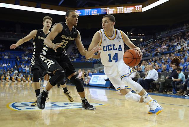 LOS ANGELES, CA - NOVEMBER 12: Zach LaVine #14 of the UCLA Bruins drives to the basket past Tommie McCune #23 of the Oakland Golden Grizzlies in the first half at Pauley Pavilion on November 12, 2013 in Los Angeles, California. (Photo by Jeff Gross/Getty Images)