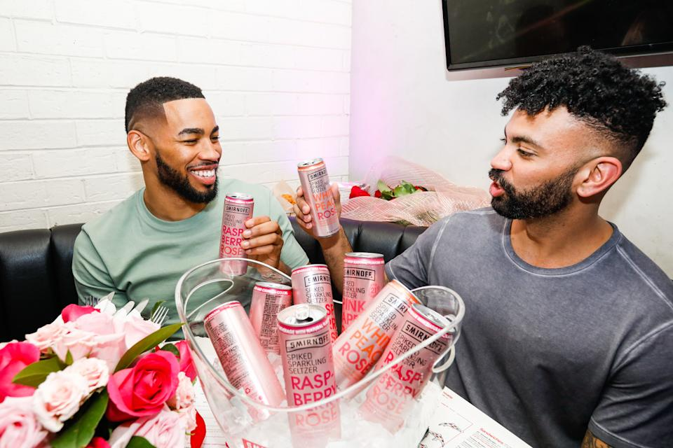 CHICAGO, ILLINOIS - MARCH 10: Mike Johnson and Dustin Kendrick react to the season finale of The Bachelor while sippingon Smirnoff Seltzer Rosés on March 10, 2020 in Chicago, Illinois. (Photo by Jeff Schear/Getty Images for Smirnoff)
