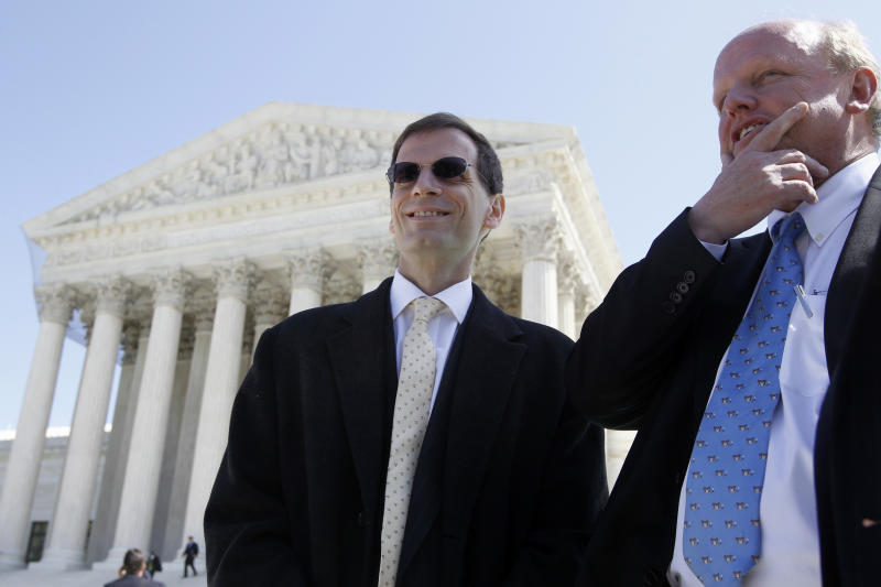 Mike Carvin, counsel for the National Federation of Independent Businesses, right, speaks with plaintiff David Klemencic who runs a flooring business in Ellenboro, W.Va., outside the Supreme Court in Washington, Tuesday, March 27, 2012, after the court heard arguments on the health care reform law signed by President Barack Obama in Washington. (AP Photo/Charles Dharapak)