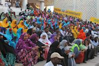 In this photo taken Monday, March 19, 2012, Somalis attend a concert by Somali singers at the Somali National Theater in Mogadishu, Somalia. An official says two of Somalia's top sports officials were killed in a suicide blast Wednesday, April 4, 2012 at Somalia's newly reopened national theater that left at least 10 dead. (AP Photo/Farah Abdi Warsameh)