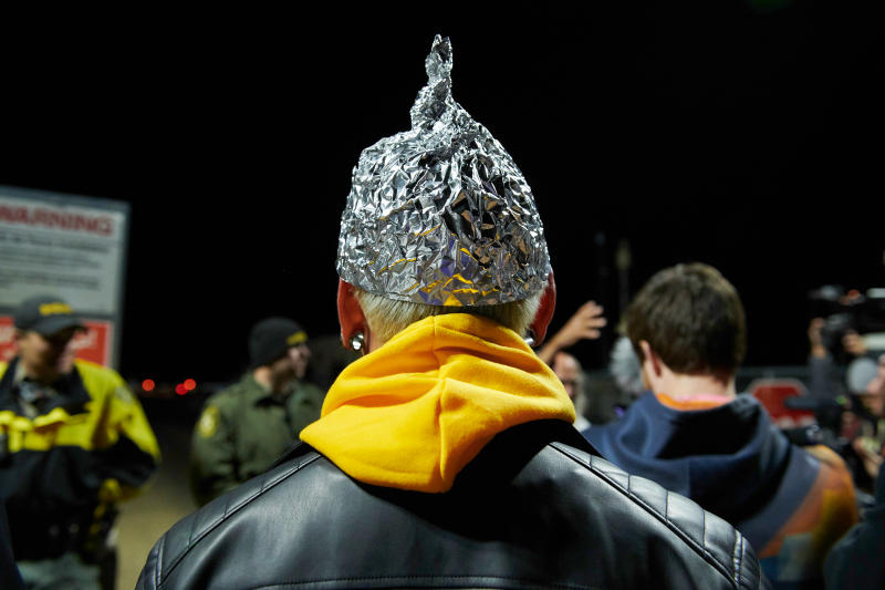 "Attendee Daniel Rodriguez wears at tinfoil hat as he and other Alien hunters gathered to ""storm"" Area 51 at an entrance near Rachel, Nevada on Sept. 20, 2019. (Photo: Bridget Bennett/AFP/Getty Images)"