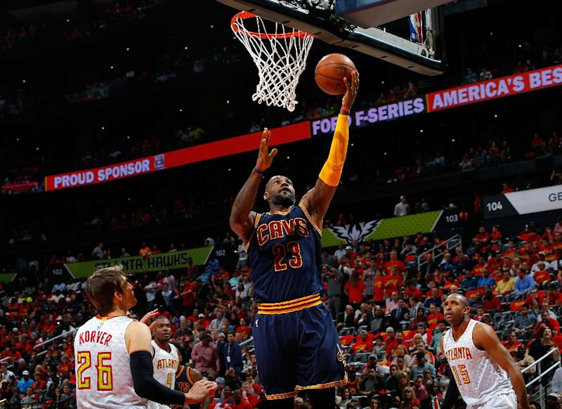 c54efa94a3c LeBron James  23 of the Cleveland Cavaliers lays in a basket against the  Atlanta Hawks