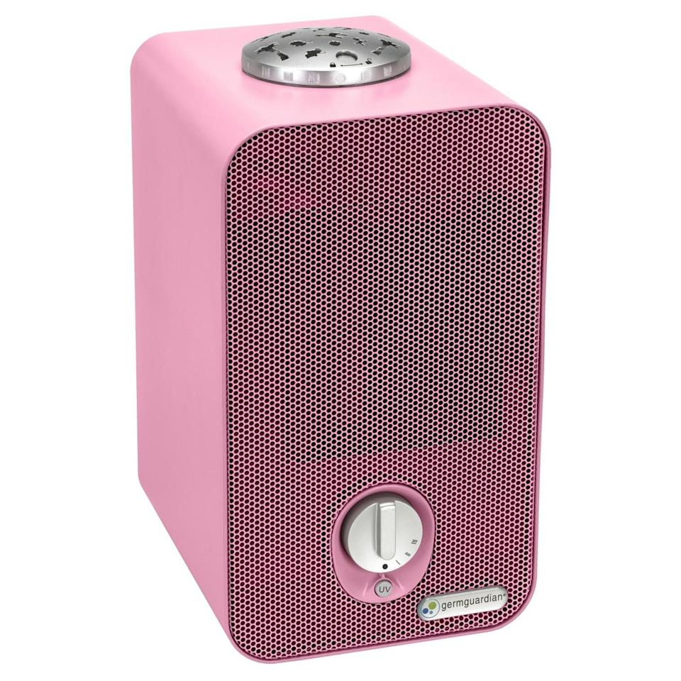 """<strong><h3>Germ Guardian Air Purifier</h3></strong><br>This pink purifier actually packs triple-purpose power with a built-in ceiling night-light projector — chicly freshen your bedroom air while setting a star, safari, or under-the-sea mood at the same damn time.<br><br><em>Shop <a href=""""https://www.wayfair.com/brand/bnd/germguardian-b20998.html"""" rel=""""nofollow noopener"""" target=""""_blank"""" data-ylk=""""slk:GermGuardian"""" class=""""link rapid-noclick-resp"""">GermGuardian</a></em><br><br><strong>Germ Guardian</strong> 4-in-1 Night-Night HEPA Air Purifier System, $, available at <a href=""""https://go.skimresources.com/?id=30283X879131&url=https%3A%2F%2Fwww.sharperimage.com%2Fview%2Fproduct%2F4-in-1%2BAir%2BPurifier%2Bwith%2BNight%2BLight%2BProjector%2F206490"""" rel=""""nofollow noopener"""" target=""""_blank"""" data-ylk=""""slk:Sharper Image"""" class=""""link rapid-noclick-resp"""">Sharper Image</a>"""