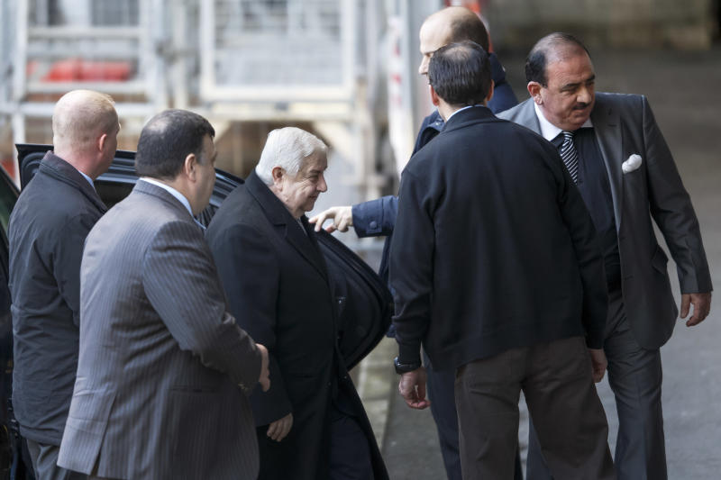 Syrian Foreign Minister Walid al-Mouallem, third left, arrives for the start of negotiations at the European headquarters of the United Nations, in Geneva, Switzerland, Friday, January 24, 2014. Al-Mouallem will meet UN-Arab League envoy for Syria Lakhdar Brahimi. (AP Photo/Keystone, Salvatore Di Nolfi)