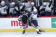 St. Louis Blues' Nathan Walker (26) sidesteps Chicago Blackhawks' Brent Seabrook, forcing Seabrook into the boards, during the second period of an NHL hockey game Monday, Dec. 2, 2019, in Chicago. (AP Photo/Charles Rex Arbogast)