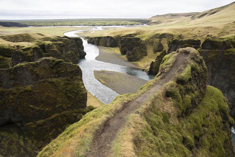 "This photo taken Wednesday, May 1, 2019, shows a cliff at the Fjadrárgljúfur canyon in southeastern Iceland. The canyon area has suffered environmental damages after intense traffic, prompted by the music video ""I'll Show You"" by Justin Bieber. (AP Photo/Egill Bjarnason)"